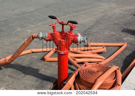 The fire hydrant with interconnected fire hoses.