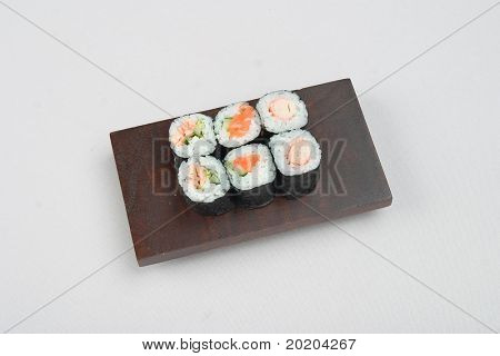 Asian food series:6 rolls of sushi on a wooden mat