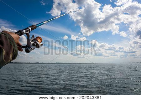 Man Hand With Fishing Rod