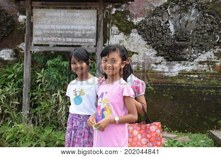BALI, INDONESIA, AUGUST 21 - Unidentified balinese children smiling at the camera