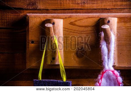 Washcloths Hanging On Wooden Hooks. Sponge For Washing On A Hanger