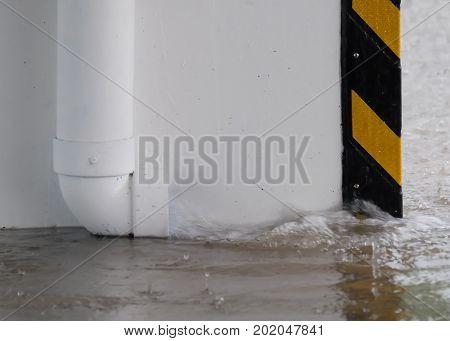 White plastic pipes drain the day of heavy rain.