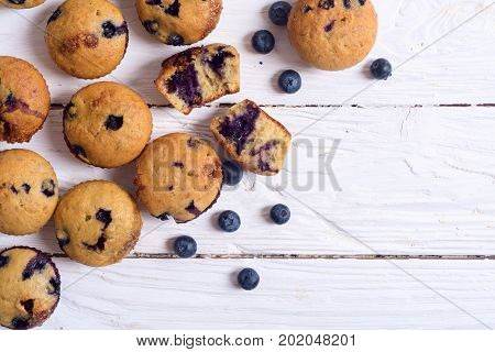 Banana muffins with blueberry on rustic background . Top view copy space