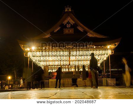 HAKONE, JAPAN - JULY 02, 2017: Unidentified people taking pictures and enjoying the lantern lights at night located in hanami in Kyoto, Japan.