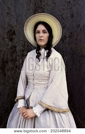 western woman near carriage in Amish village