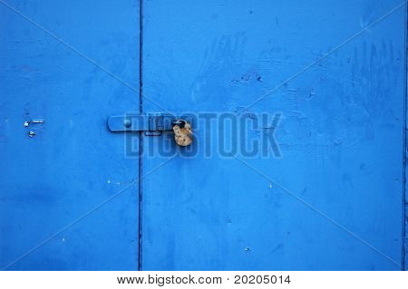 simple and effective background image of a padlock on a door painted bright blue
