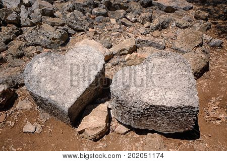 Stones in shape of hearts on ground