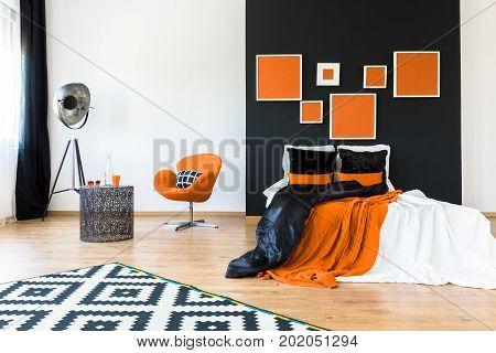 Orange Chair In Retro Bedroom