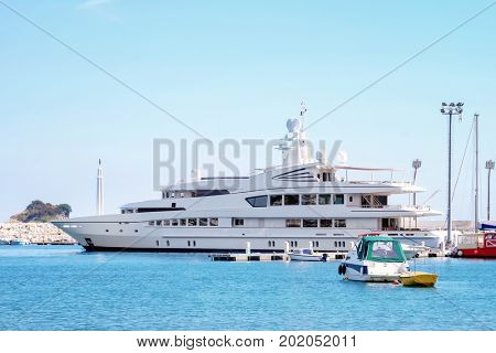 Seascape with beautiful white yacht on sunny day