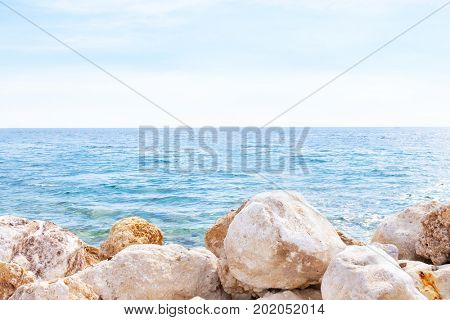 View of blue sea and rocky shore