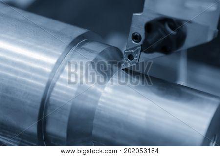 CNC lathe machine cutting tool cutting the aluminium part.Hi-precision CNC machining concept.