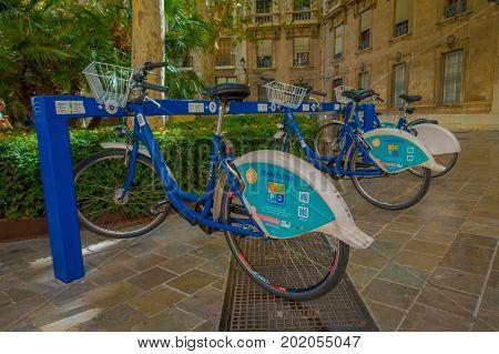 PALMA DE MALLORCA, SPAIN - AUGUST 18 2017: Free public rental bikes parked in a rack in Palma de Mallorca, Balearic islands, Spain.