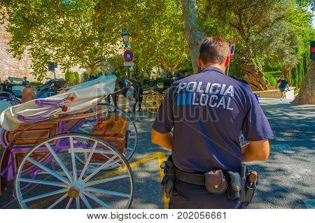PALMA DE MALLORCA, SPAIN - AUGUST 18 2017: Police officers at Boulevard Born in Palma de Mallorca, Spain, Europe.
