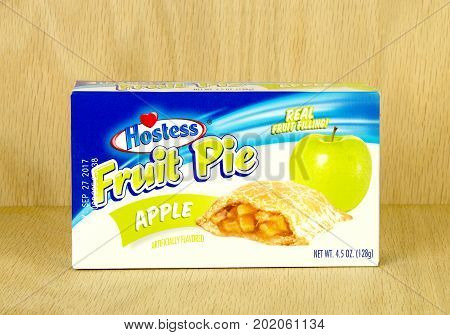 RIVER FALLS,WISCONSIN-AUGUST 30,2017: A Hostess brand apple pie box with a wood background.