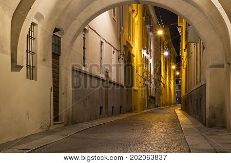 Ancient street Borgo Longhi lit by streetlights at night city Parma Emilia-Romagna province Italy. Europe. Famous place of tourist destination. City of creative gastronomy under the auspices of UNESCO