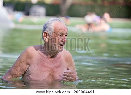 Old Man Resting In Pool