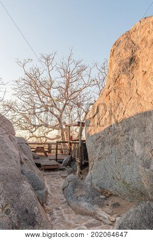 HOADA NAMIBIA - JUNE 27 2017: A viewpoint between boulders on a hill at the Hoada Camp in the Kunene Region of Namibia