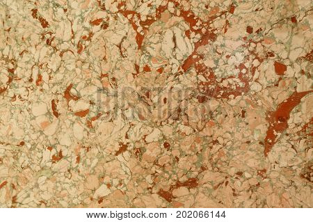 Abstract marble effect on water called ebru. Mixed red yellow and green colors. Unusual background for poster book card invitation texture.