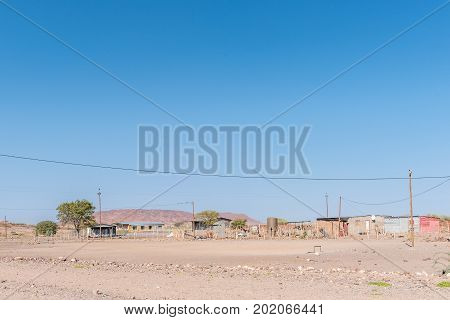 BERGSIG NAMIBIA - JUNE 28 2017: A street scene with houses in Bergsig a small village in the Kunene Region of Namibia