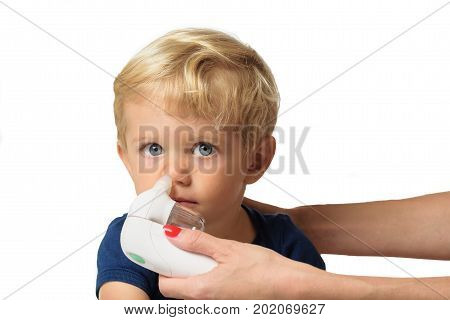Mother using baby electric nasal aspirator. She is doing a mucus suction to twenty months baby boywhite backgrounds.