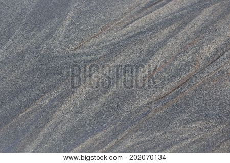 Grey and brown sand & silt texture.