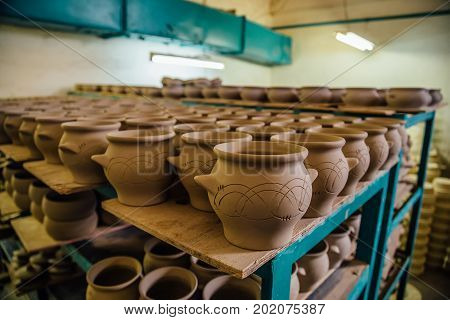 Pottery workshop. Drying unbaked pottery after molding.