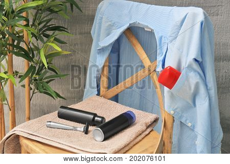 Set of items for male hygiene on chair