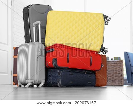 Different suitcases in light room. Luggage overweight concept