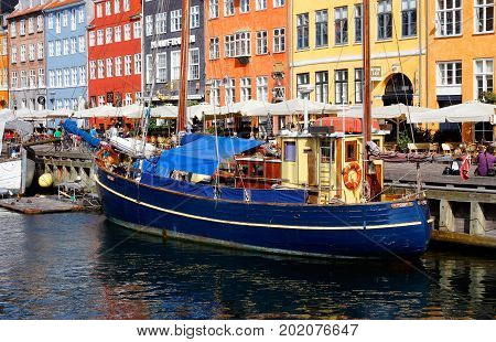 Copenhagen Denmark - August 24 2017: View of Nyhavn with a fishing boat.