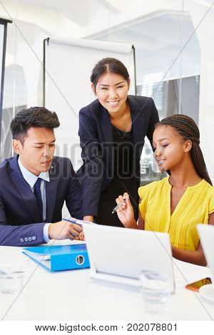 Interracial business team working together in meeting