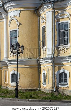Fragment of the Resurrection Cathedral. The style of Baroque architecture. A window is open in one window. There is a black lantern. Russian Northern City Vologda. Russia