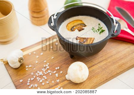 Bowl With Mushroom Cream Soup Decorated With Sliced Champignons