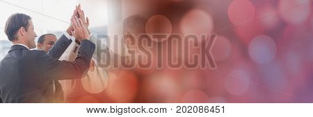 Digital composite of Business team putting hands together and red bokeh transition