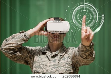 Digital composite of Military man in VR headset touching interface