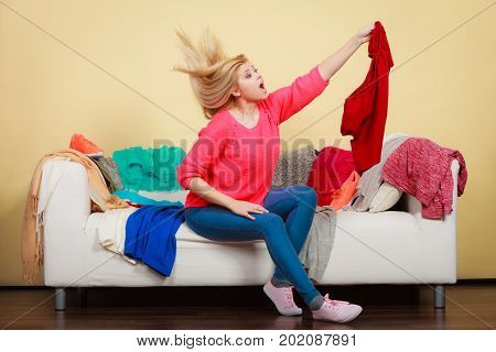 Woman Does Not Know What Wear Sitting On Couch