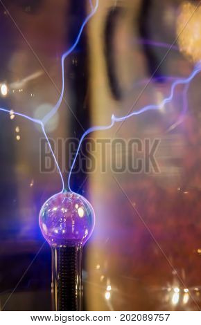 Close up centre of plasma ball emitting electric sparks