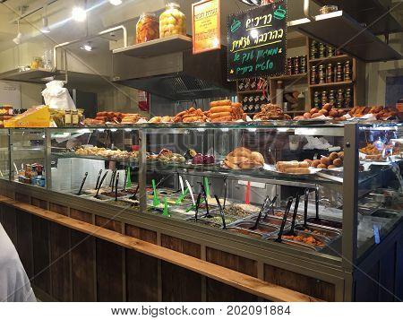 TEL AVIV, ISRAEL - MARCH 31, 2016: Street food cafe in the new Sarona Market, Tel Aviv, Israel.