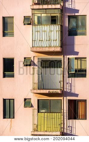 Vertical view of three balconies in an apartment building in Valparaiso Chile