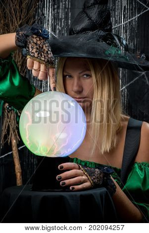 Beautiful Witch On A Black Background With A Magic Ball