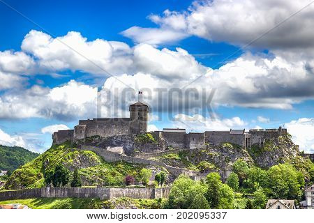 Chateau Fort on a cloudy sky background. Lourdes, Pyrenees, France