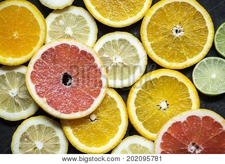 Closeup of fresh citrus fruit slices background