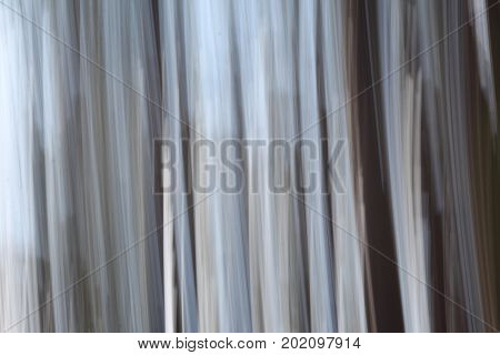 Beautiful abstract background with soft gray, black and white tones, a technique known as panning to photographers.