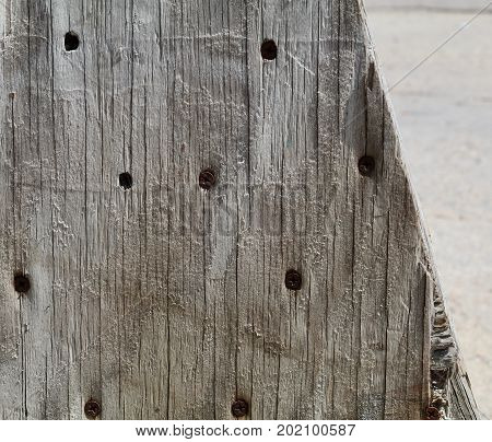 Old grey wood with dark screws showing