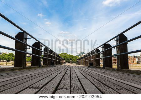 Wooden Pier. Low angle view of a wooden pier stretching out into the distance. London UK.