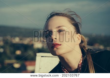 Woman posing on blurred natural landscape. Girl with red lips makeup on face vintage filter. Beauty and youth concept. Summer vacation and wanderlust