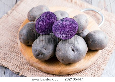 Purple sweet potato on a wooden table