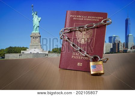 Russian foreign passport with metal chain and lock. USA Department of State blocked limited US visa issue for Russian people. US Anti russian sanctions. Sanctions campaign propaganda illustration