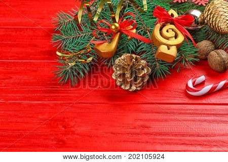 Beautiful composition with fir tree branches and decorations on color wooden background. Christmas music concept