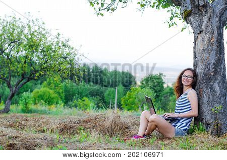Young Woman Working On Laptop Outdoors, Free Space.