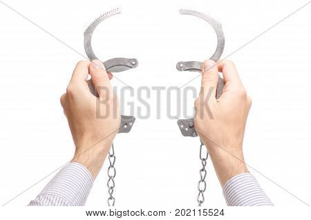 Male hand cuffs isolated on white background isolation